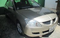 Well-maintained Mitsubishi Lancer 2006 GLX MT for sale