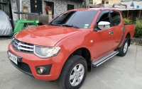 Selling Red Mitsubishi Strada 2014 at 49000 km in Quezon City