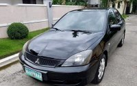 Selling 2nd Hand Mitsubishi Lancer 2011 Automatic Gasoline at 90000 km in Parañaque