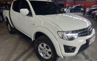 Selling White Mitsubishi Strada 2014 Automatic Diesel