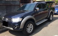 Selling Mitsubishi Strada 2014 Automatic Diesel in Quezon City