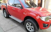 Sell Red 2014 Mitsubishi Strada at 92000 km