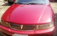 Selling Red Mitsubishi Lancer 2001 Manual Gasoline