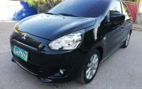 Selling Black Mitsubishi Mirage 2014 at 26000 km