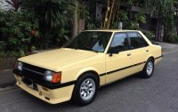 Selling Yellow Mitsubishi Lancer 1987 at 6000 km
