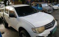 Selling White Mitsubishi Strada 2013 Manual Diesel at 55000 km