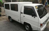 Selling White Mitsubishi L300 2013 in Quezon City