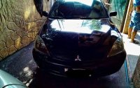 Black Mitsubishi Lancer 2010 for sale in Quezon City