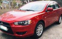 Selling Red Mitsubishi Lancer Ex 2010 Automatic Gasoline