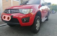 Sell Red 2013 Mitsubishi Strada in Quezon City