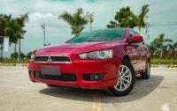 Sell Red 2013 Mitsubishi Lancer Ex at 66000 km