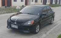 Black Mitsubishi Lancer 2005 for sale in Dasmarinas