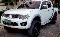 White Mitsubishi Strada 2010 for sale in Taguig