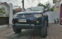Sell Black 2012 Mitsubishi Strada in Bamban