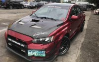 Red Mitsubishi Lancer 2010 for sale in Manila