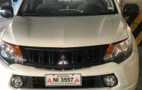 Selling White Mitsubishi Strada 2016 in Caloocan