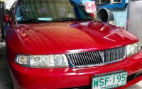 Red Mitsubishi Lancer 2001 for sale in Quezon City