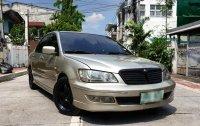 Selling White Mitsubishi Lancer 2003 in Manila