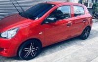 Red Mitsubishi Mirage 2013 Hatchback for sale in Manila