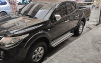 Black Mitsubishi Strada 2015 for sale in Manila