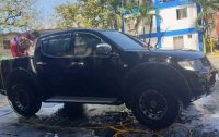Black Mitsubishi Strada 2010 for sale in Guguinto