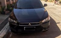 Black Mitsubishi Lancer 2014 for sale in Quezon City