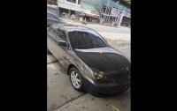 Black Mitsubishi Lancer 2008 for sale in Malolos City
