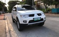 Pearl White Mitsubishi Montero Sport 2013 for sale in Quezon City