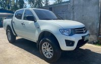 Sell White Mitsubishi Strada in Lipa