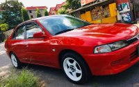 Red Mitsubishi Lancer for sale in Quezon City