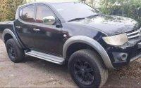 Sell Black 2011 Mitsubishi Strada in Los Baños