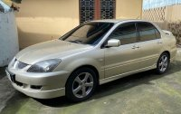 Pearlwhite Mitsubishi Lancer 2007 for sale in Quezon