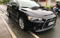 Selling Black Mitsubishi Lancer 2014 in Batangas