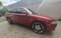Red Mitsubishi Lancer 2004 for sale in Taytay