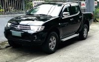 Black Mitsubishi Strada 2012 for sale in Quezon