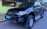 Sell Black 2013 Mitsubishi Strada in Manila