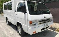 White Mitsubishi L300 2015
