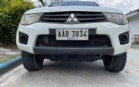 White Mitsubishi Strada 2013