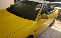 Yellow Mitsubishi Lancer 1994 for sale in Pateros
