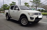 Selling White Mitsubishi Strada 2012 in Makati