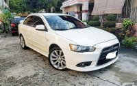 Selling Pearl White Mitsubishi Lancer 2010 in Quezon City