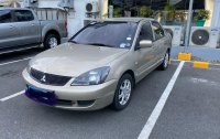 Selling Silver Mitsubishi Lancer 2010 in Quezon City