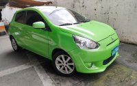 Selling Green Mitsubishi Mirage 2013 in Quezon City