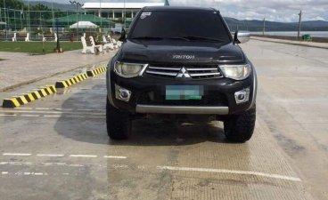 Black Mitsubishi Strada 2012 for sale in Cebu