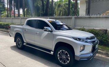Selling Pearl White Mitsubishi Strada 2019 in Pasig
