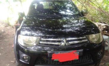 Selling Black Mitsubishi Strada 2010 in Manila