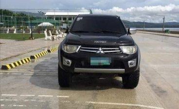 Selling Black Mitsubishi Strada 2012 in Cebu City