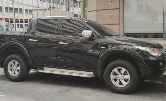 Black Mitsubishi Strada 2015 for sale in Manila