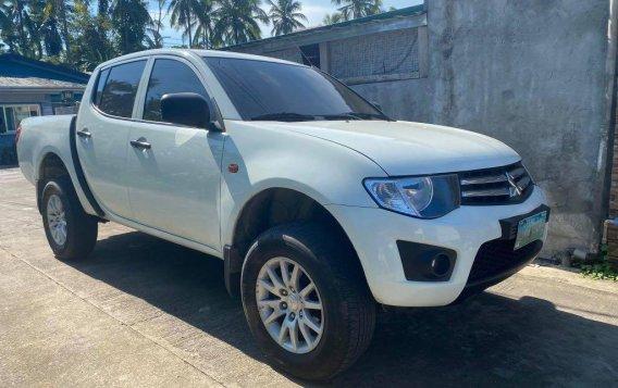 Sell White Mitsubishi Strada in Lipa