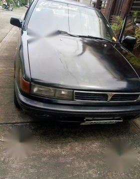 Black Mitsubishi Lancer 2004 for sale in Calamba